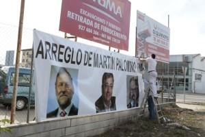 Cartel de protesta en Martin Palomino